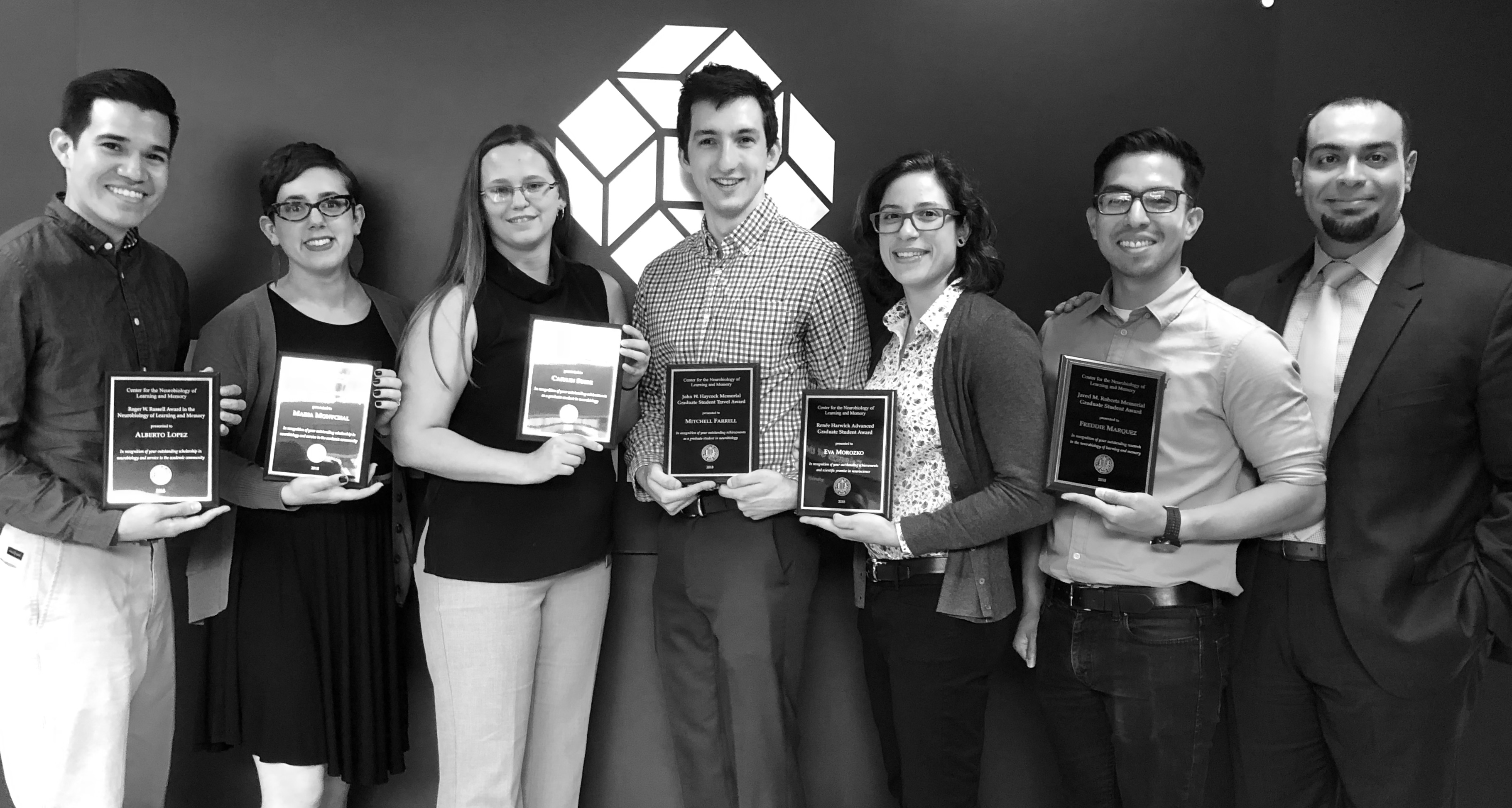 Graduate Student Award Recipients Alberto Lopez, Maria Montchal, Caitlin Suire, Mitchell Farrell, Eva Morozko and Freddie Marquez pose with CNLM Director Dr. Michael Yassa